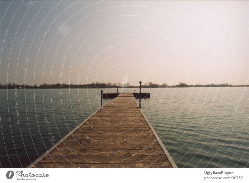 Steg am Badesee Wasser Sonne See Horizont