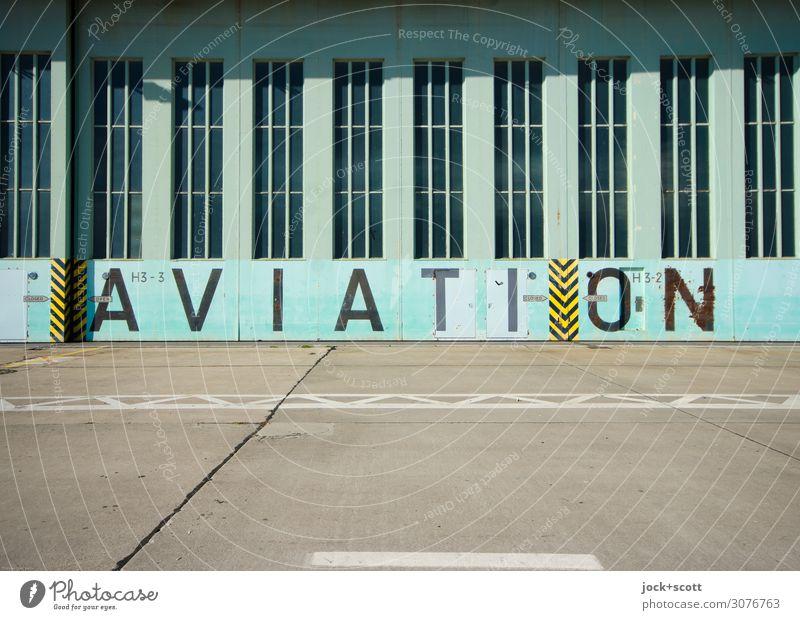AVIATION Berlin-Tempelhof Flughafen Hangar Tor Sehenswürdigkeit Flugplatz Beton Metall Wort Englisch groß historisch retro türkis Stil Symmetrie Vergangenheit