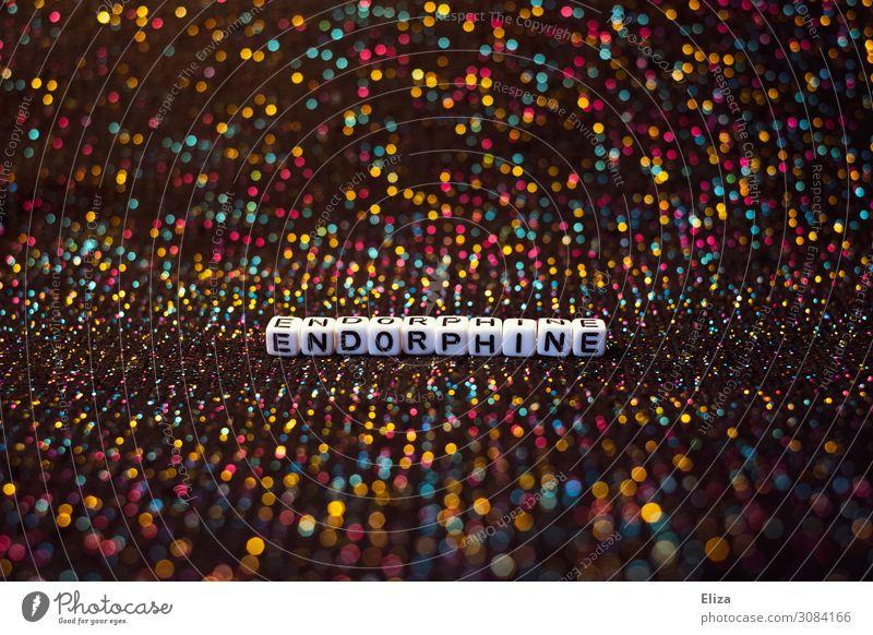 Das Wort Endorphine auf bunt glitzerndem Hintergrund. Konzept Drogen, Party und Rausch. Nachtleben Partydrogen Feste & Feiern clubbing Tanzen Freude Glück