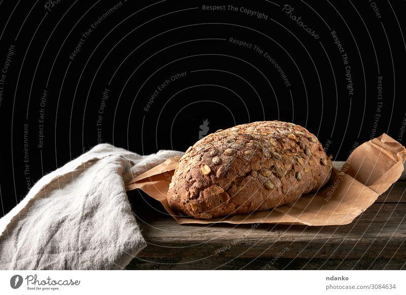 gebackenes ovales Brot aus Roggenmehl Ernährung Frühstück Diät Tisch Holz dunkel frisch braun grau schwarz Tradition Bäckerei Lebensmittel Feinschmecker Korn