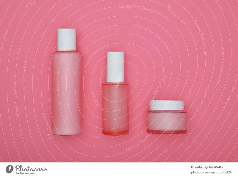 Set von Schönheitscreme-Flaschen auf rosa Hintergrund schön Körperpflege Haare & Frisuren Haut Gesicht Kosmetik Creme Schminke Gesundheit Gesundheitswesen Glas