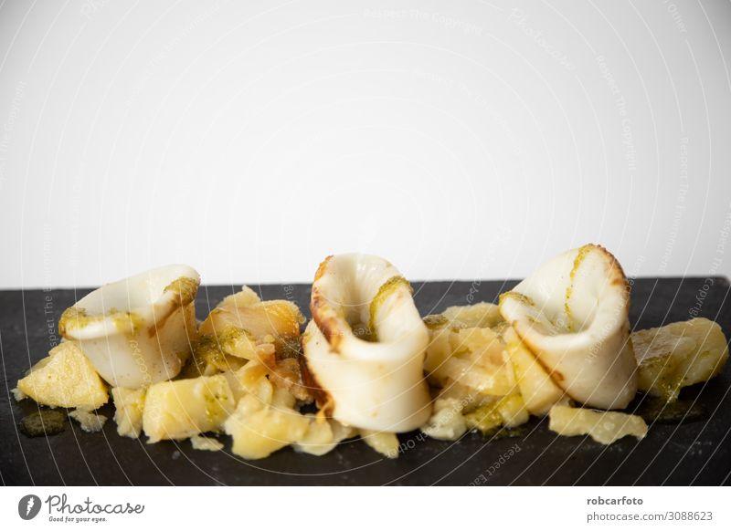 Spanisches Tintenfisch-Top mit Kartoffeln Meeresfrüchte Mittagessen Abendessen Teller Tisch Restaurant Holz frisch lecker rot Tradition Amuse-Gueule Hintergrund