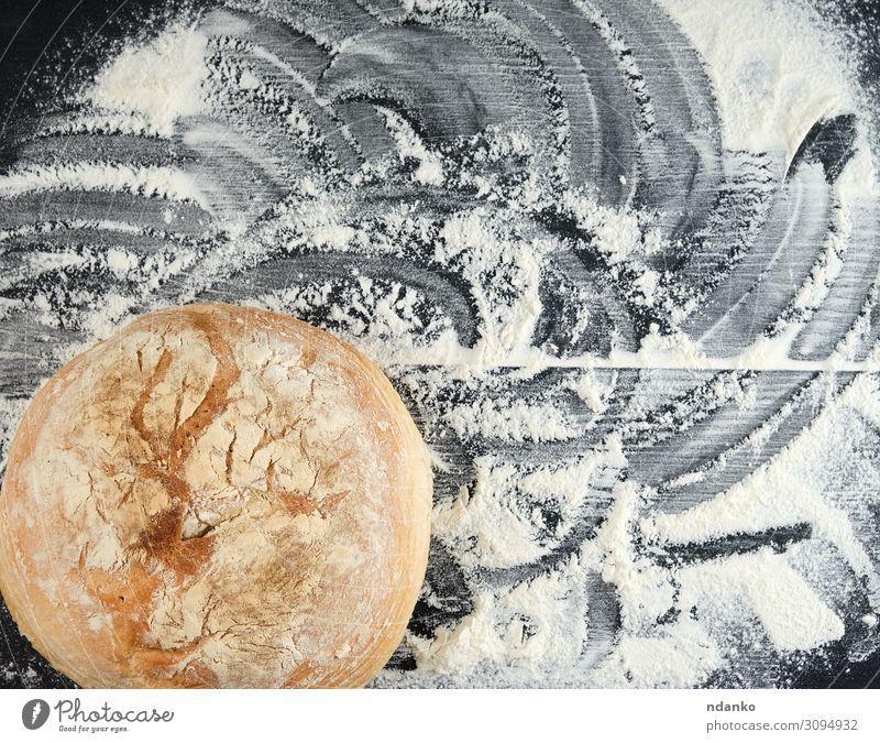 rundes gebackenes Brot und weißes Weizenmehl Ernährung Mittagessen Tisch Küche Holz dunkel frisch groß natürlich braun schwarz Tradition Bäcker Bäckerei