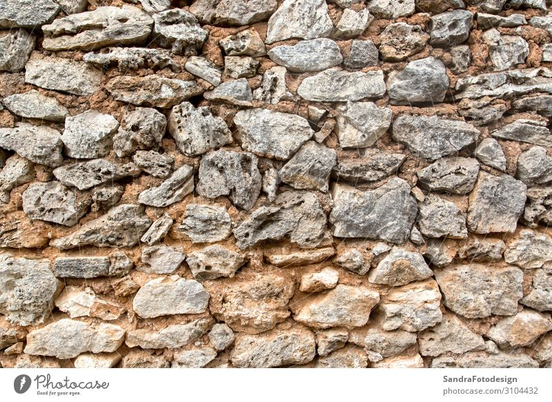 A texture of stones, also suitable as a background Design Natur Erde Mauer Wand retro aged aging ancient antique architecture Hintergrundbild brick brown cement