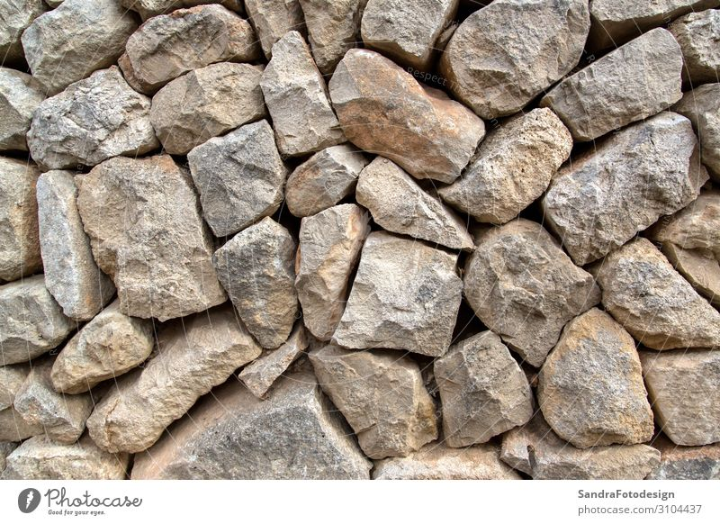 A texture of stones, also suitable as a background Design Natur Mauer Wand alt aged aging ancient antique architecture Hintergrundbild brick brown cement close