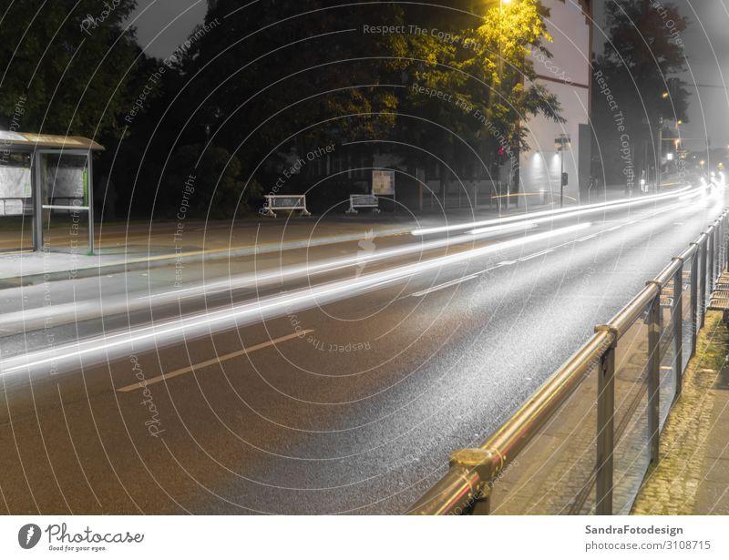 Road at night with light trails of cars Ferien & Urlaub & Reisen Umwelt Regen Verkehr Straßenverkehr Autobahn PKW fahren achtsam gewissenhaft motion road street