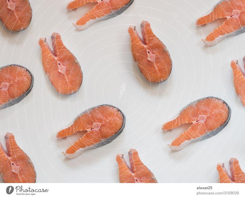 Lachssteakmuster auf weißem Hintergrund Meeresfrüchte frisch natürlich oben rot Entwurf Essen zubereiten Fett Fisch Lebensmittel Feinschmecker Gesundheit