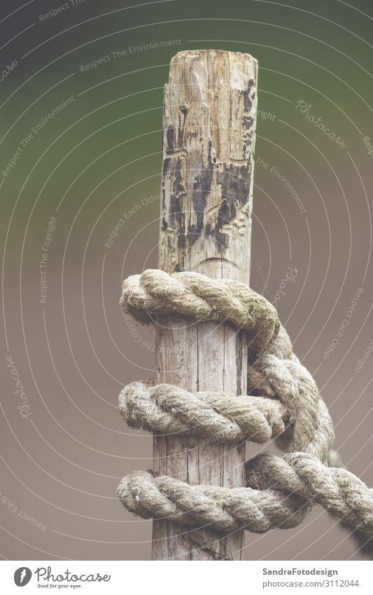 Knot from a rope on a wood Garten Feld Jachthafen weich grau Wege & Pfade boat captured close cord cross Dock fastener god holding knot line natural nautical