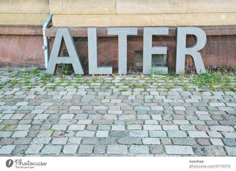 ALTER Straße Wand Stein Buchstaben Asphalt Kopfsteinpflaster Wort schwer