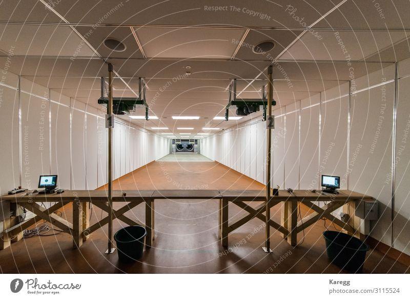 in a large indoor shooting range can train sport shooters Freude Freizeit & Hobby Jagd Sommer Entertainment Veranstaltung Mensch Frau Erwachsene Park Ziel rifle