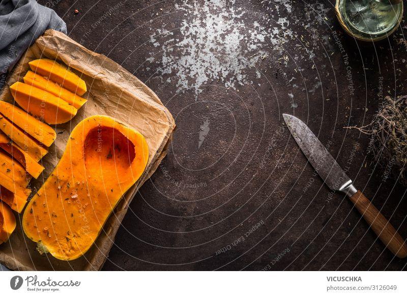 Hintergrund mit Butternusskürbis Lebensmittel Gemüse Ernährung Bioprodukte Vegetarische Ernährung Diät Messer Stil Design Gesunde Ernährung Tisch Erntedankfest