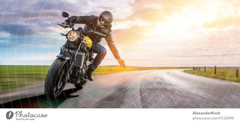 man on a motorbike on the road riding. having fun driving Lifestyle Freude Ferien & Urlaub & Reisen Sport Motor Mensch Motorrad berühren entdecken Fitness