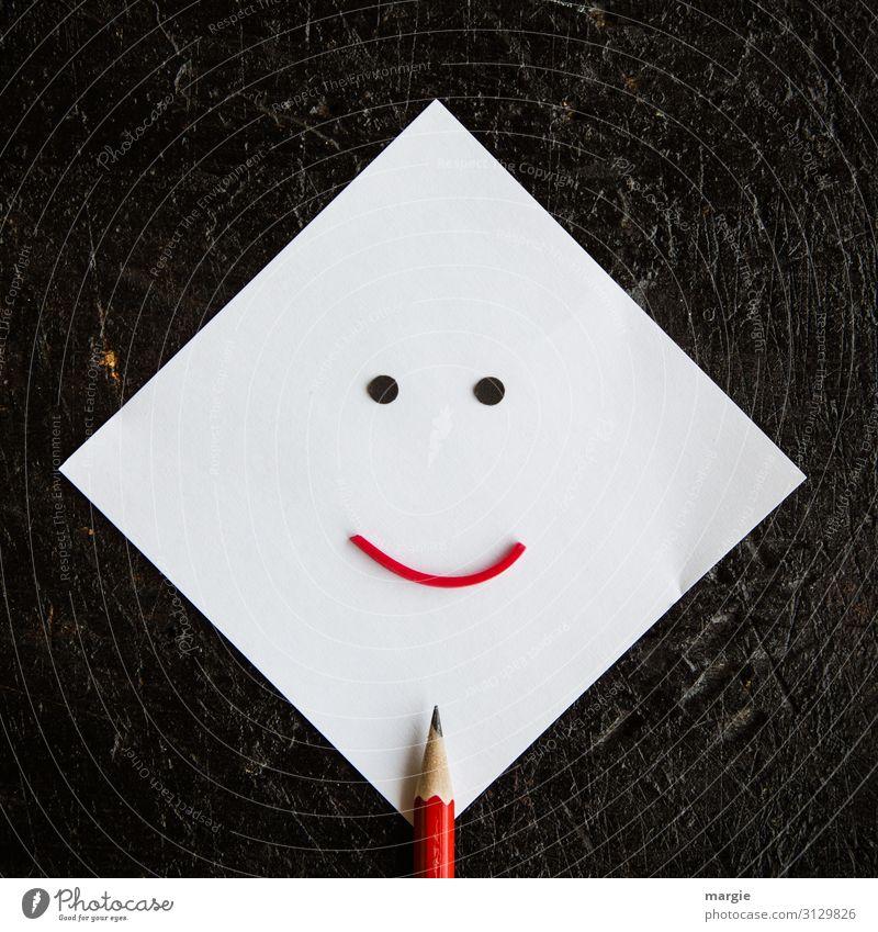 Notizzettel mit Bleistift als Smiley Arbeit & Erwerbstätigkeit Büroarbeit Arbeitsplatz schreiben rot Zettel Papier Schriftsteller Schreibstift weiß schwarz