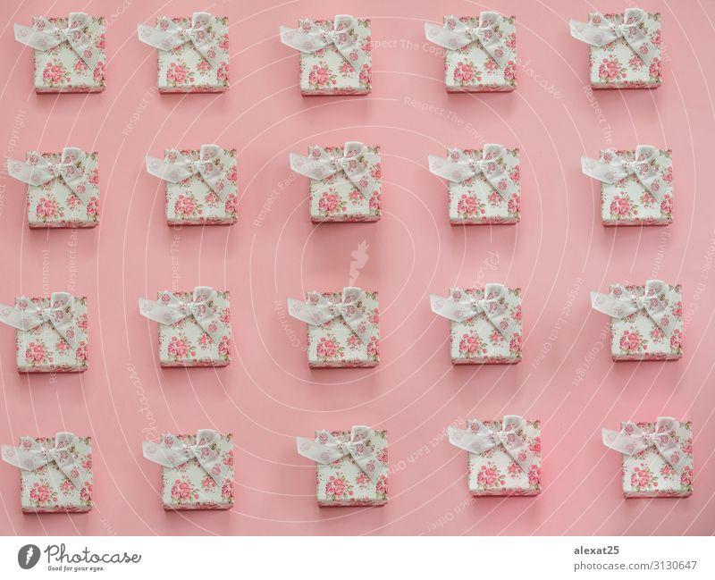 Geschenk-Muster auf rosa Hintergrund Design Dekoration & Verzierung Feste & Feiern Weihnachten & Advent Geburtstag Kunst Papier Paket Ornament Schnur hell neu