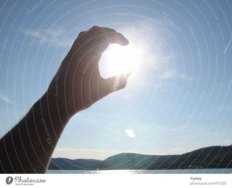 SunCatcher Hand Himmel Sonne fangen umschließen