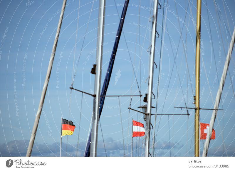 Flaggen im Wind II Deutschland Tourismus Deutsche Flagge Hafen Fahne Schweiz Österreich Fahnenmast Mast Bodensee