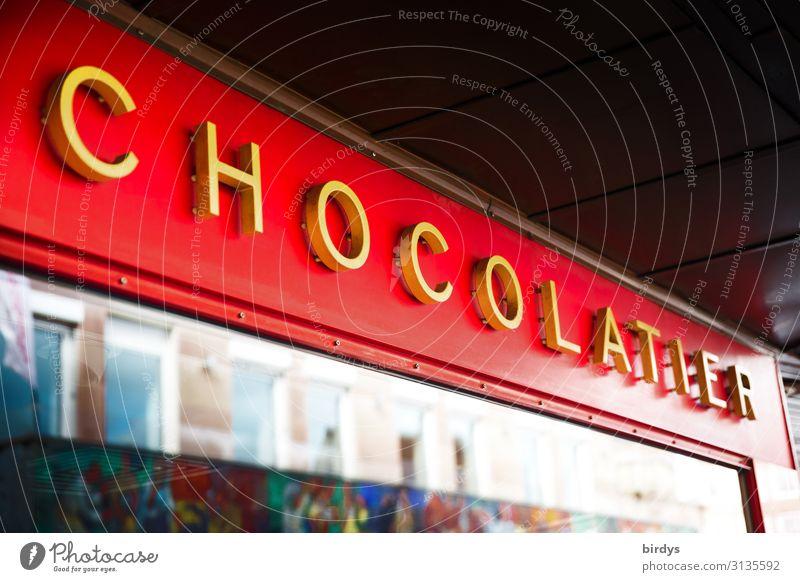 Schokoladenladen Stadt rot gelb süß Schriftzeichen genießen authentisch kaufen Süßwaren Duft Reichtum Gesellschaft (Soziologie) positiv Appetit & Hunger