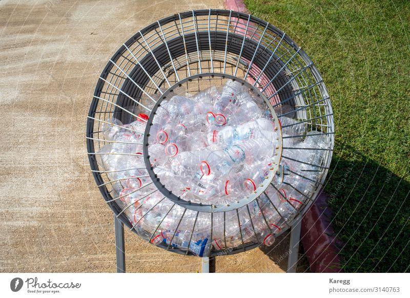 plastic bottles are collected in a metal basket schön Kind Mensch Klima Verpackung Kunststoffverpackung Sack Container Glas Zeichen trashig Recycling cheerful