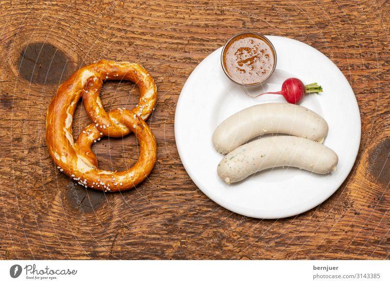 bayerische Weißwurst Wurstwaren Gemüse Frühstück Mittagessen Getränk Alkohol Bier Teller Tisch Oktoberfest Kultur Holz rot weiß Tradition aufsicht Brezel