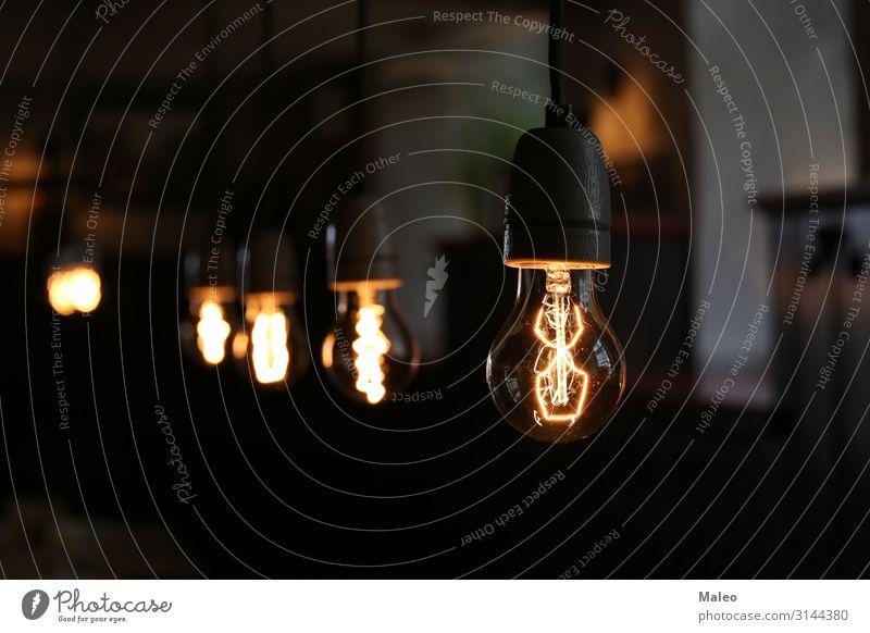 Klassische elektrische Glühlampe klassisch Glühbirne Hintergrundbild schwarz hell Lampe Konzepte & Themen Konzert Kreativität Design Elektrizität Energie
