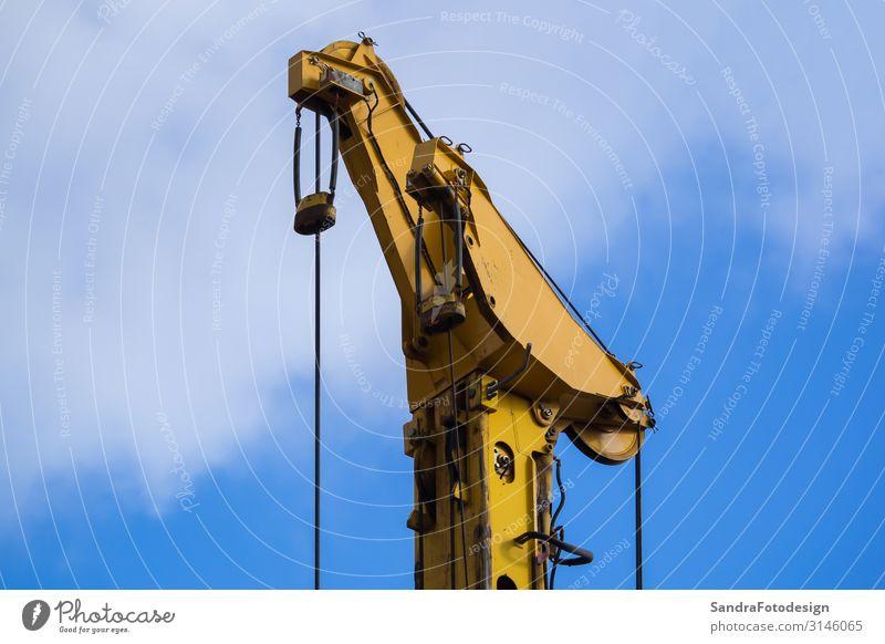 Detail view from a yellow crane in front of blue sky Haus Hausbau Renovieren Arbeit & Erwerbstätigkeit Handwerker Arbeitsplatz Baustelle Industrie Business