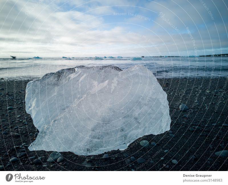 Ice chunks on the black beach of Iceland Ferien & Urlaub & Reisen Sommer Strand Natur Sand Himmel Blick Schnellzug Island jokulsarlon landscape natural water
