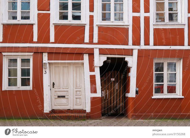 Gesellenstück Ferien & Urlaub & Reisen Stadt Farbe rot Haus Fenster Architektur Wand Kunst Mauer Fassade Stadtleben Häusliches Leben Tür Glas Kreativität