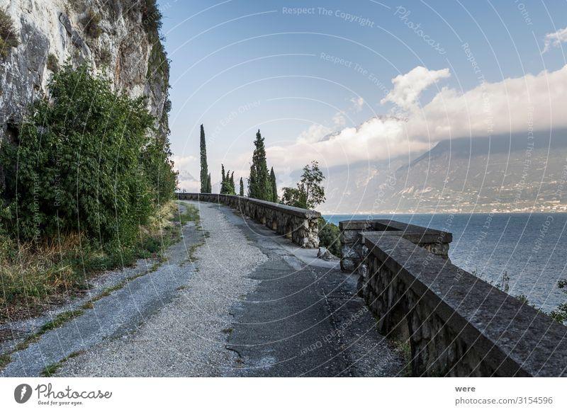 old road on the shores of Lake Garda Ferien & Urlaub & Reisen Tourismus Ferne Sommerurlaub Sonne Tunnel Erholung fahren Recreation Road car damaged decay