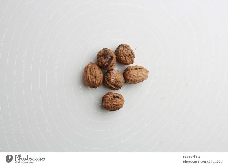Knoblauchwalnüsse in farbigem Hintergrund Ernährung Vegetarische Ernährung Diät Tisch Menschengruppe Natur Holz natürlich braun offen altehrwürdig Gesundheit