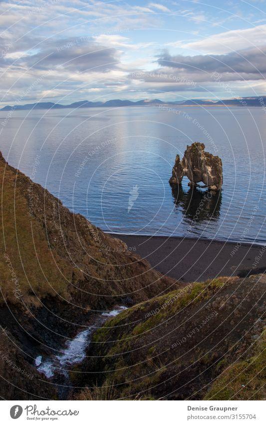 Troll rock in Iceland stands in the sea Ferien & Urlaub & Reisen Tourismus Abenteuer Expedition Sommer Strand Umwelt Natur Landschaft Klima Klimawandel