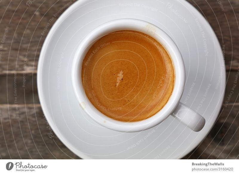 Fukk Tasse Espresso-Kaffee aus der Nähe Frühstück Kaffeetrinken Getränk Heißgetränk Becher Holz weiß Kaffeetasse Tisch Porzellan Untertasse Crema Kaffeepause