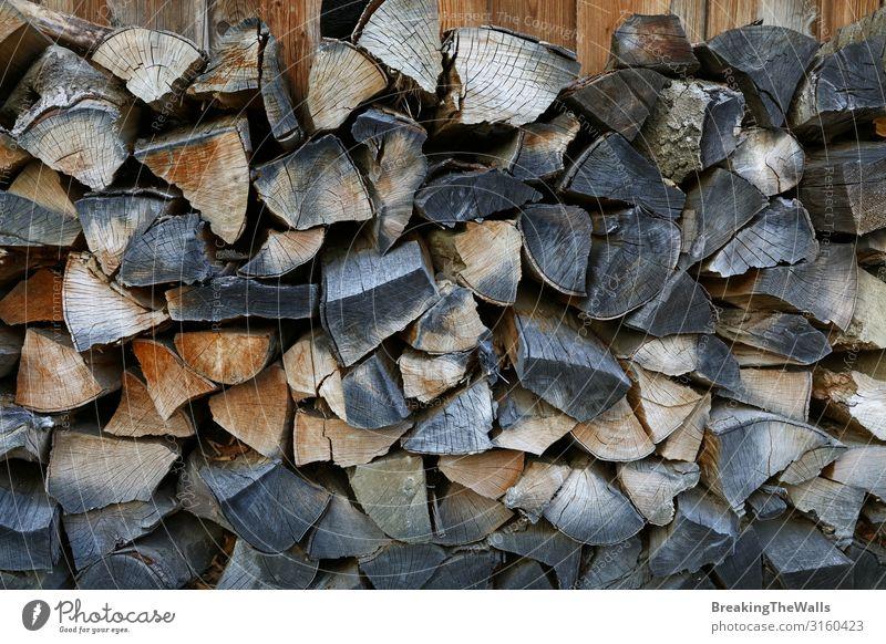 Ein Haufen Brennholzvorräte Lifestyle Haus Dekoration & Verzierung Energiewirtschaft Holz dunkel trocken braun Anhäufung Stapel Holzstapel Brennstoff