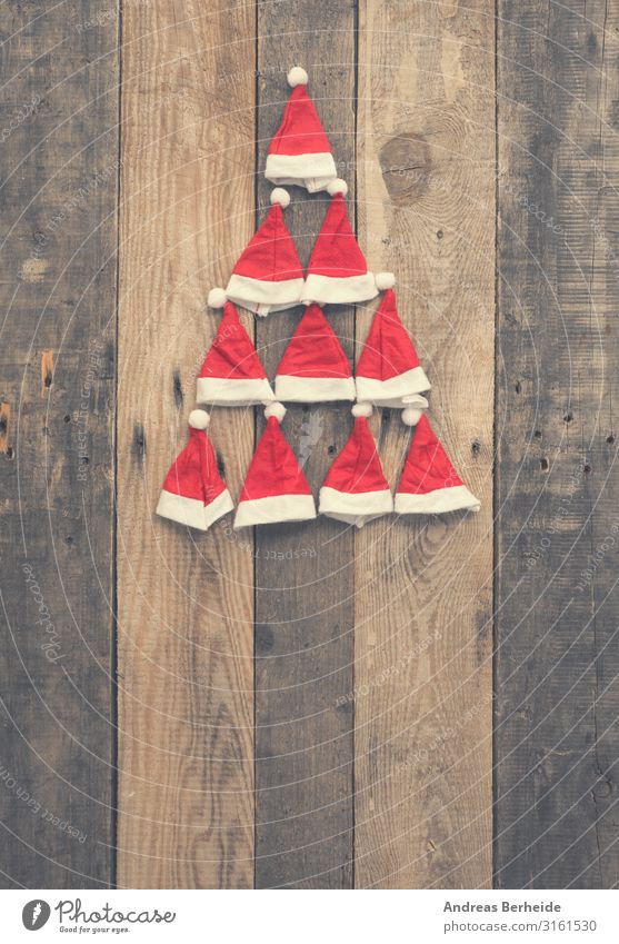 Christmas tree shape made with hats of Santa Stil Winter Weihnachten & Advent Hut Mütze Holz Ornament Tradition Weihnachtsmann red rustic plank wooden nobody