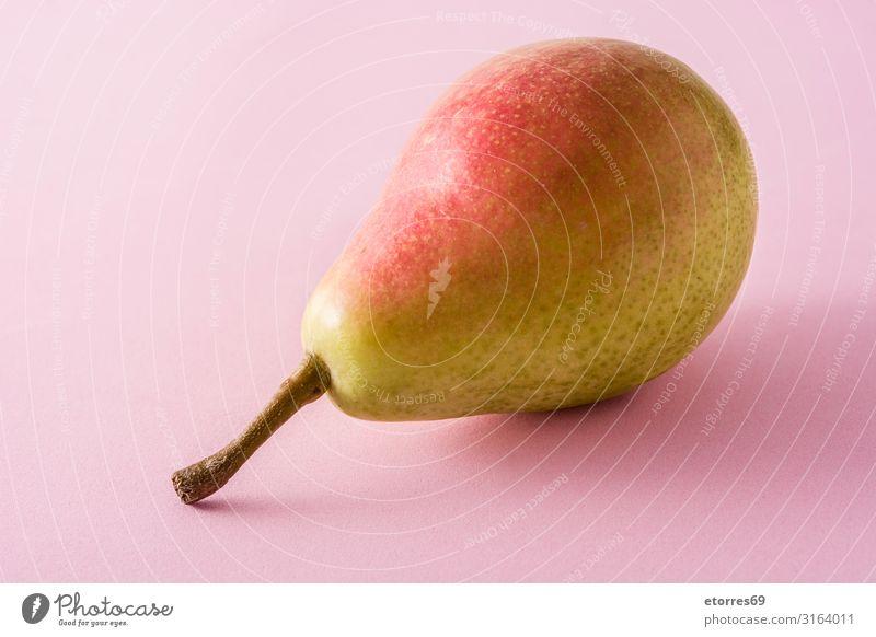 Gesunde, frische Birne auf rosa Hintergrund Frucht Lebensmittel Gesunde Ernährung Foodfotografie Tradition Snack Gesundheit Vitamin grün natürlich Ercolini