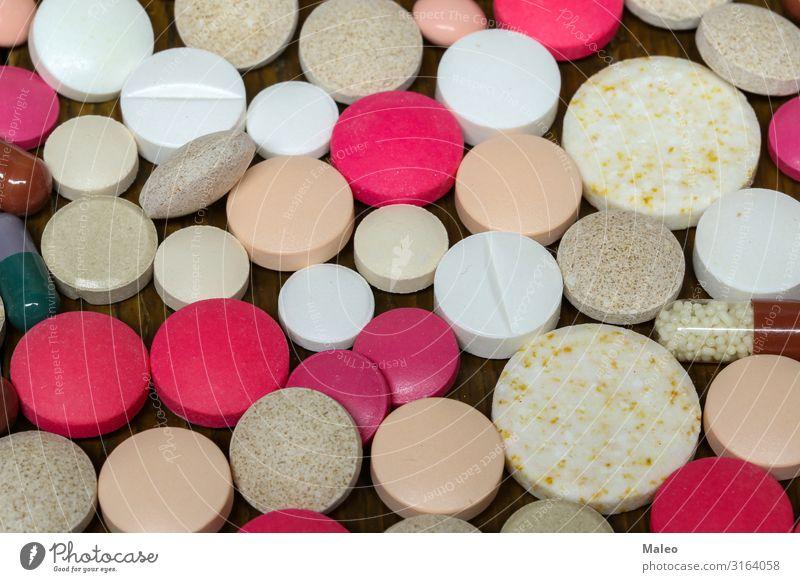 Verschiedene Pillen und Kapseln liegen auf dem Tisch Gesundheit Konzepte & Themen Dose Tablette rot Medikament Apotheke Gesunde Ernährung Die Pille