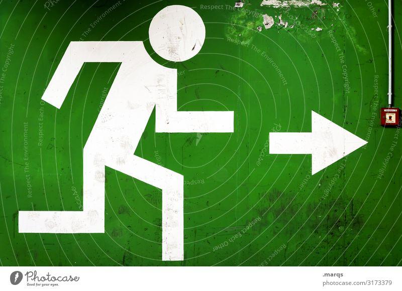 Exit Piktogramm mit Feuermelder Zeichen Notausgang Fluchtweg grün Pfeil Panik Ausweg Ziel Rettung richtungweisend Wand Angst flüchten Ausgang Richtung