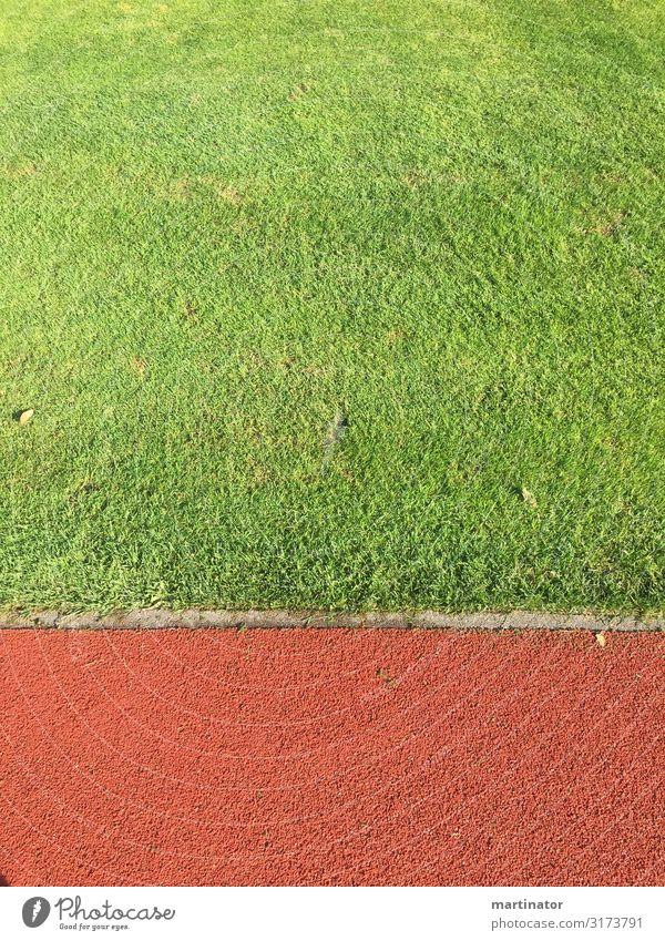 sportplatz detail Sport Ballsport Leichtathletik Joggen Fußballplatz Stadion laufen laufstadion Rasen Wiese Stadt modern grün rot Klarheit minimalistisch