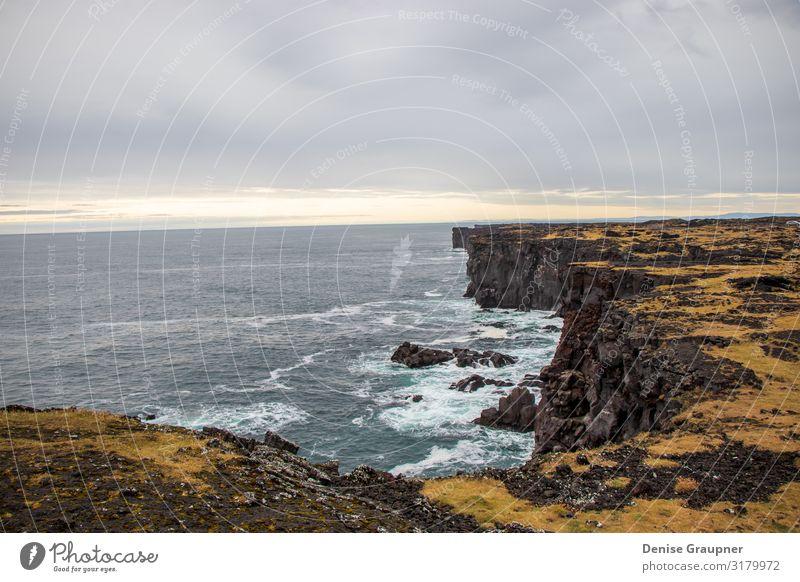 rough rugged coastline in Iceland Sommer Umwelt Natur Landschaft Wolken Klima schlechtes Wetter Ferien & Urlaub & Reisen Surrealismus Island landscape mountain