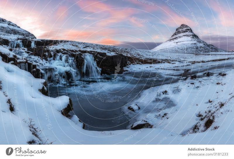 Islands Landschaft kirkjufell Berge u. Gebirge Winter Natur Himmel Snæfellsnes Wasserfall schön Schnee blau Ferien & Urlaub & Reisen Außenaufnahme kalt weiß