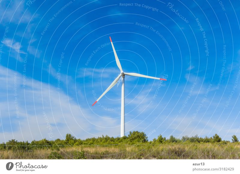 Rotating windmill generating renewable energy wind power at land Wirtschaft Energiewirtschaft Business Erfolg Technik & Technologie Wissenschaften Fortschritt