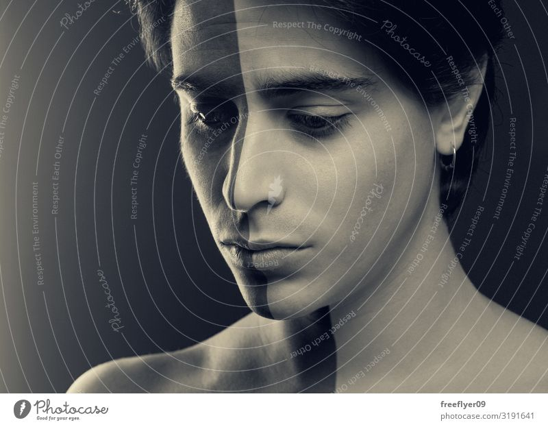 Mensch Jugendliche Mann 18-30 Jahre Gesicht Erwachsene Traurigkeit Haut Kreativität Idee Teilung Surrealismus Verschiedenheit Entwurf Hälfte Heilung
