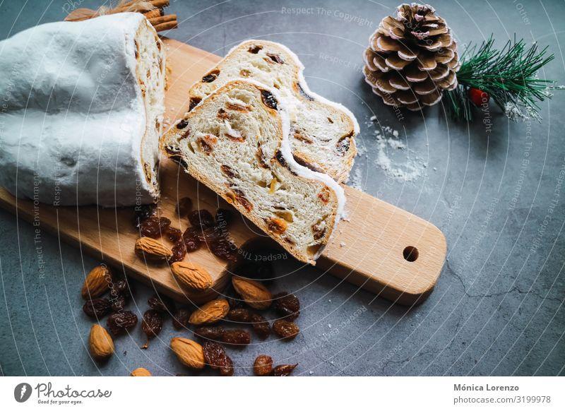 Weihnachtsstollen mit Zimt, Anis und Mandeln. Frucht Brot Dessert Kräuter & Gewürze Winter Feste & Feiern Tradition Zucker Ingwer süß Scheibe Pasteten orange