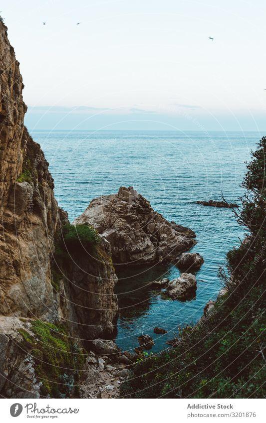 Schlucht in Felsen mit Meeresbucht Bucht Abenddämmerung Küste Lagune Klippe Formation Wasser Ferien & Urlaub & Reisen Sonnenuntergang Dämmerung Landschaft Natur