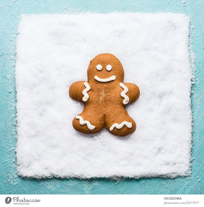 Lebkuchenmännchen auf Schnee. Ernährung Design Freude Winter Weihnachten & Advent Tradition Hintergrundbild grinsen Symbole & Metaphern Lebkuchenmann