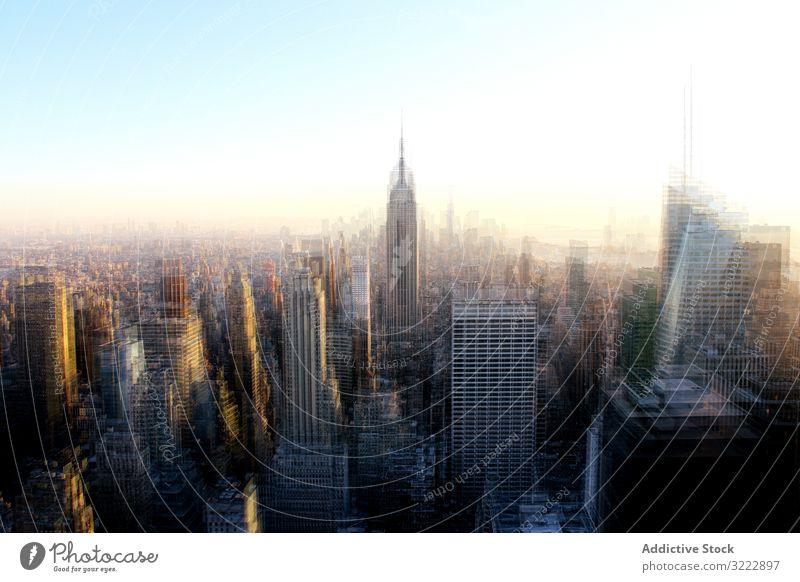 Landschaft mit Hochhäusern in New York verschwommen New York State Wolkenkratzer Morgen Stadtbild Skyline früh Architektur urban Sonnenlicht Gebäude