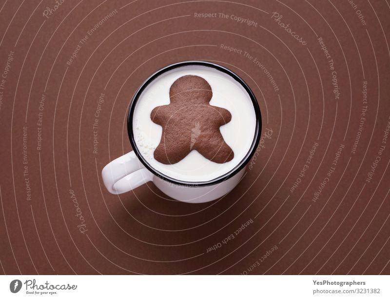 Lebkuchenmann in der Milchtüte. Milch und Kekse. Weihnachts-Bonbons Dessert Süßwaren Essen trinken Heißgetränk Tasse Becher Freude Winter Weihnachten & Advent