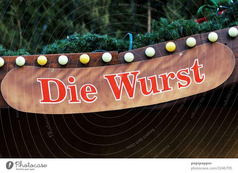 Die Wurst Lebensmittel Wurstwaren Ernährung Essen Mittagessen Fastfood Fingerfood Weihnachten & Advent Grünpflanze Mauer Wand Lampenlicht Glühbirne Zeichen