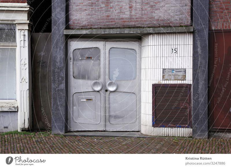 nummer 15 Haus Hintergrundbild Architektur Gebäude Textfreiraum Stein braun Fassade grau Metall retro Tür Fliesen u. Kacheln Backstein Material Eingang