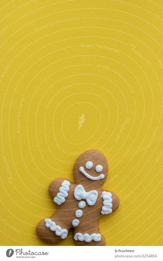 Lebkuchenmann Lebensmittel Teigwaren Backwaren Süßwaren Ernährung Gesunde Ernährung Zeichen genießen Freundlichkeit Fröhlichkeit frisch gelb Weihnachtsmann