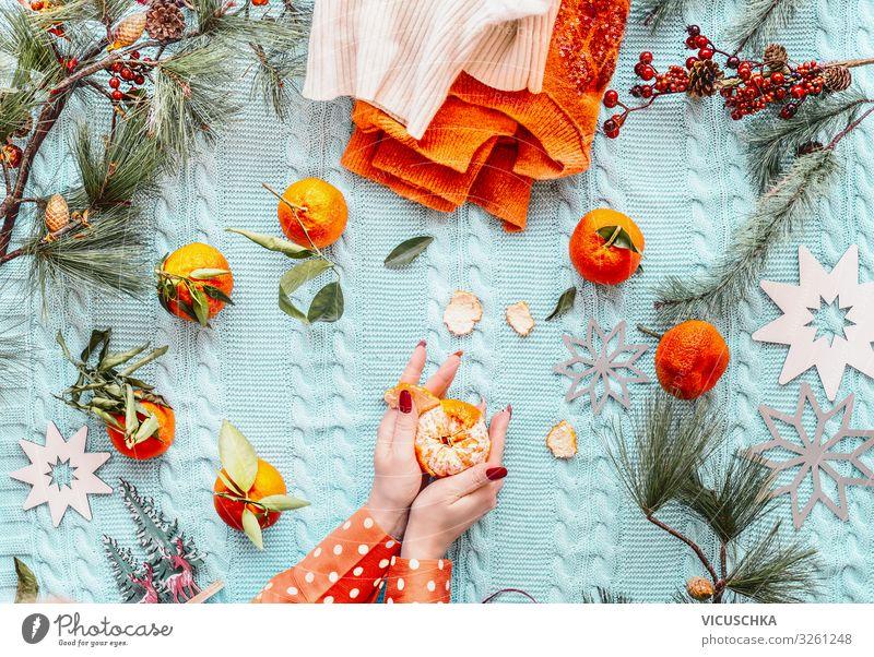 Female hands in orange polka dot blouse pell oranges Design Winter Häusliches Leben Weihnachten & Advent Mensch Frau Erwachsene Hand Pullover Tradition